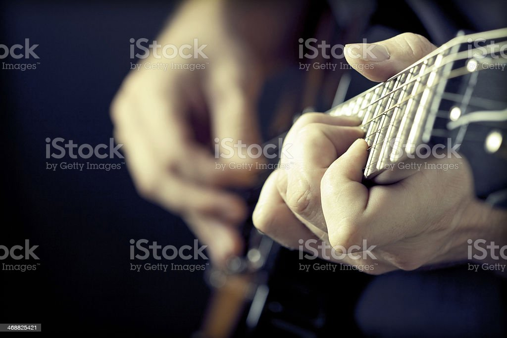 Man playing guitar stock photo