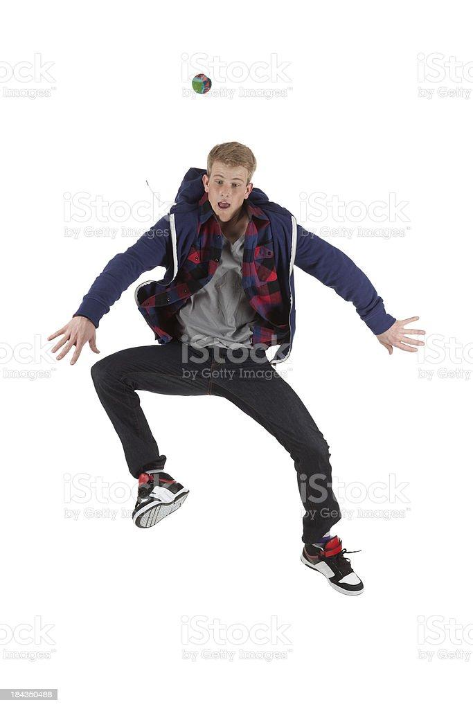 Man playing hacky sack stock photo