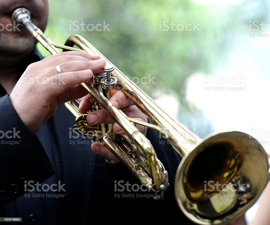 Man playing his trumpet outside royalty-free stock photo