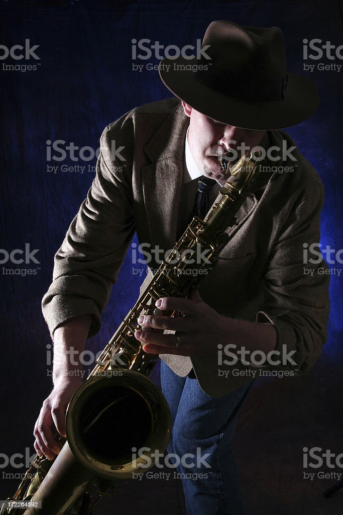 man playing jazz on saxophone stock photo