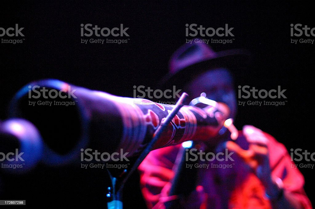Man playing on didgeridoo stock photo