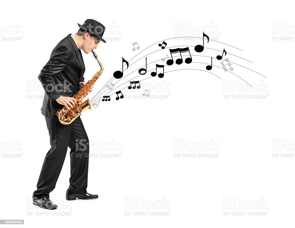 Man playing on saxophone and notes coming out stock photo