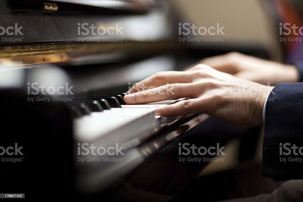 Man playing piano stock photo