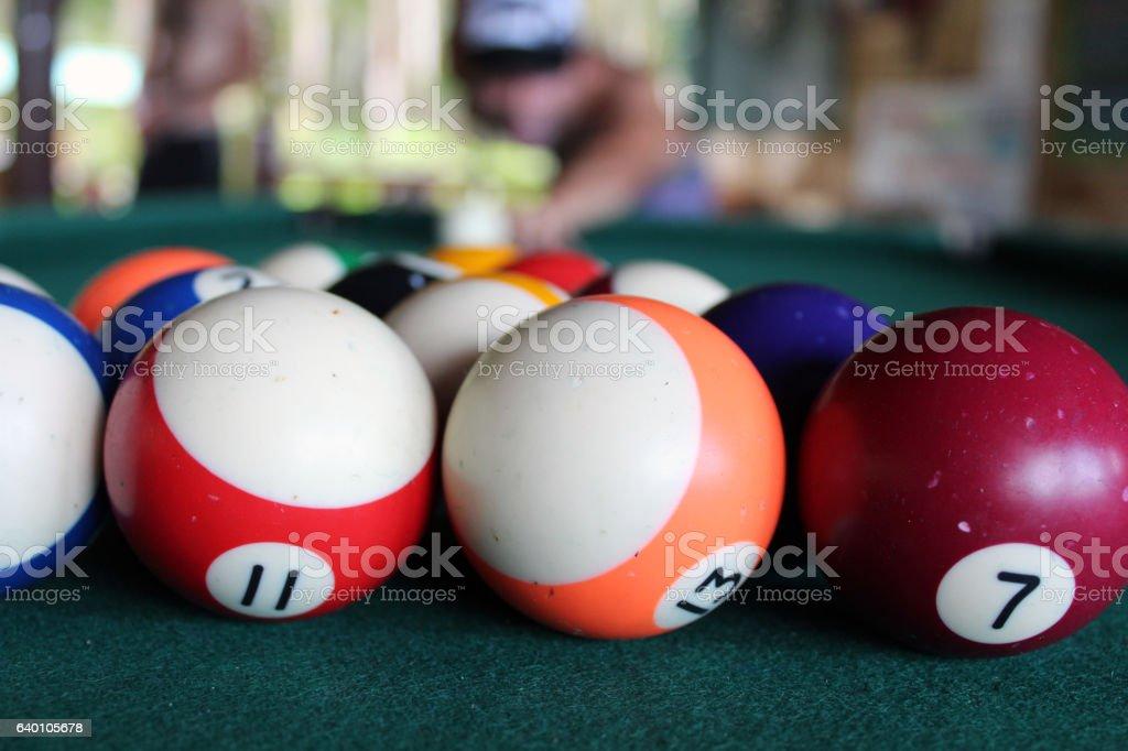 Man playing pool with pool ball closeup stock photo