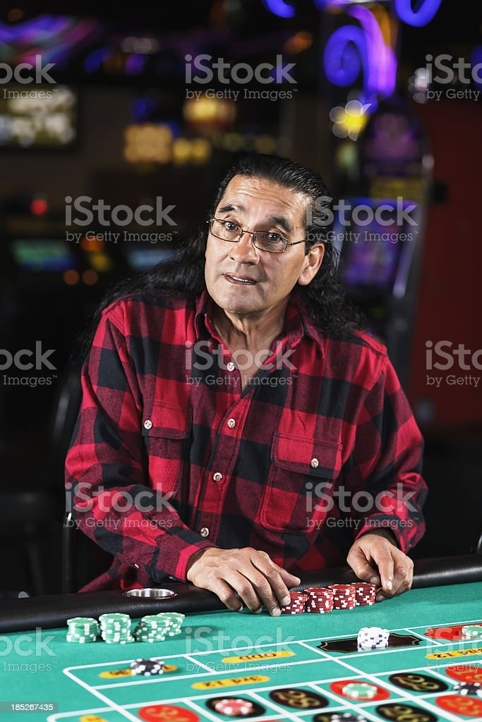 Man Playing Roulette In a Casino royalty-free stock photo