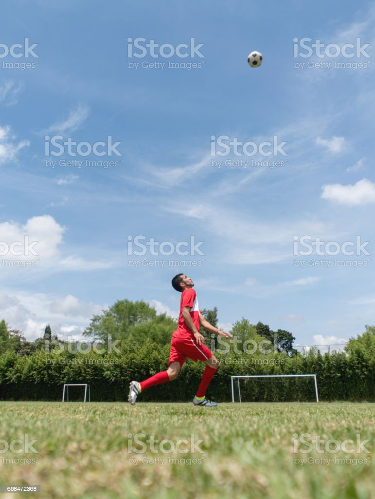 Man playing soccer at the field stock photo