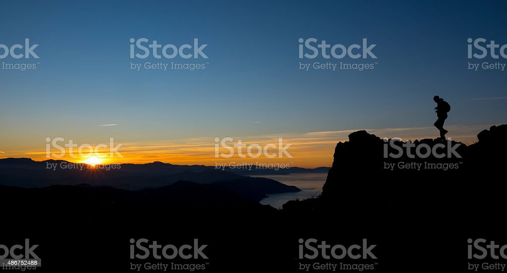 Man playing sports on the mountain. stock photo