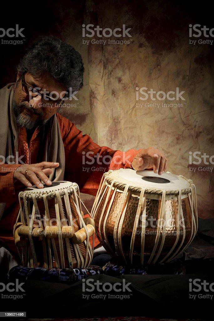 Man playing tabla stock photo