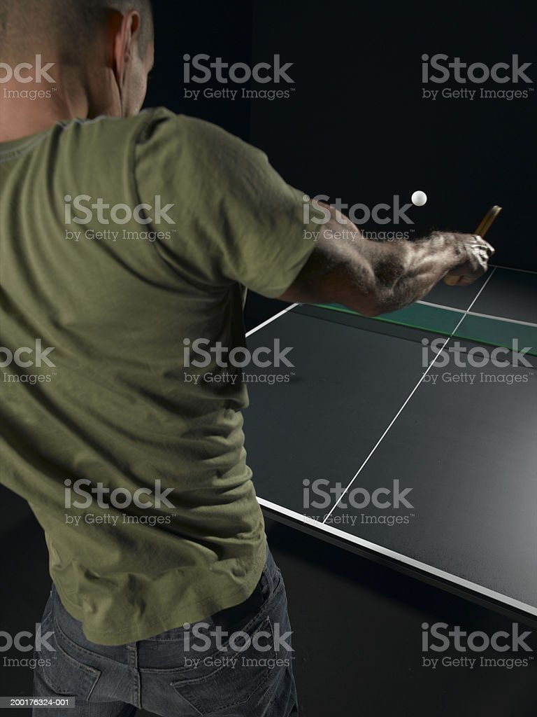 Man playing table tennis, rear view royalty-free stock photo