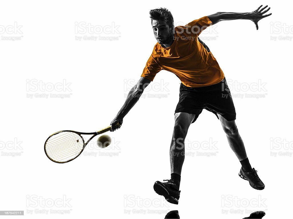 Man playing tennis on a white background royalty-free stock photo