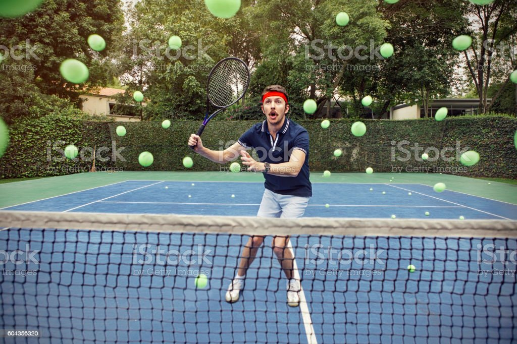Man playing tennis stock photo