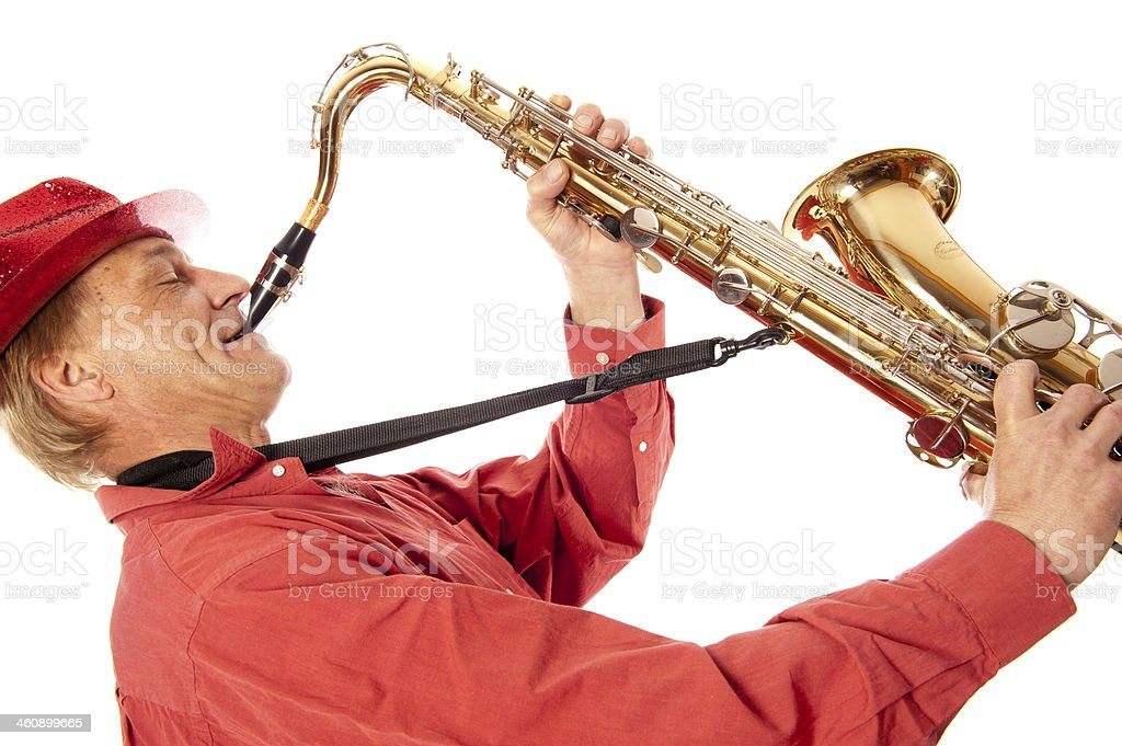 Man playing tenor saxophone enthousiastically stock photo