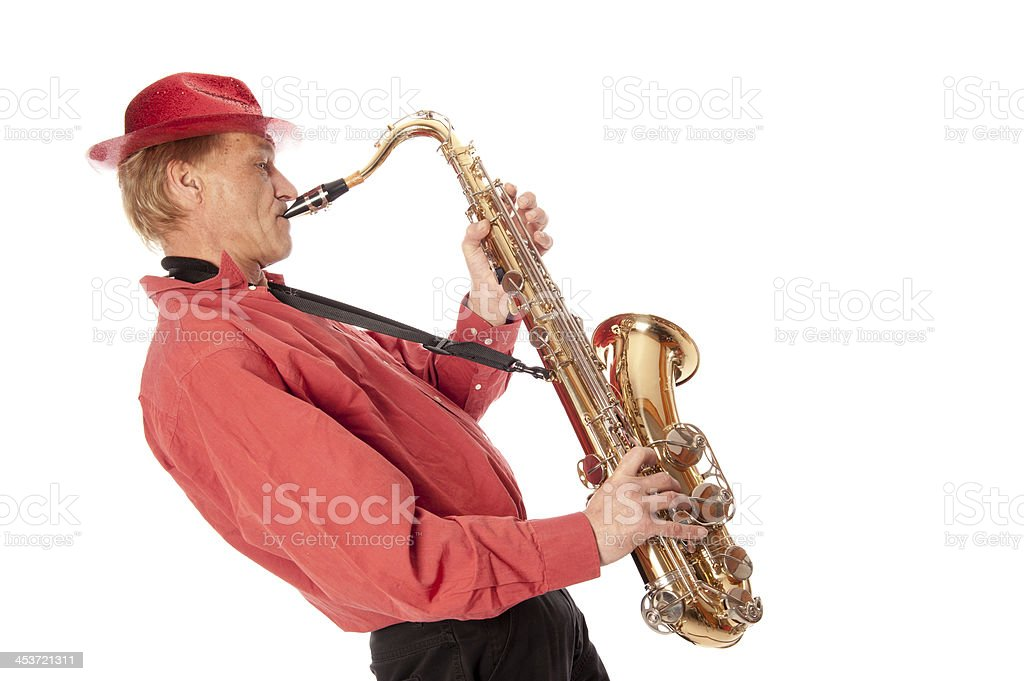 Man playing tenor saxophone leaning backwards stock photo