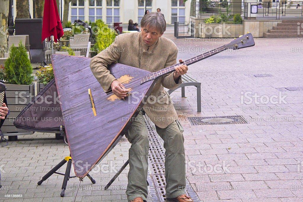 Man playing the balalaika stock photo