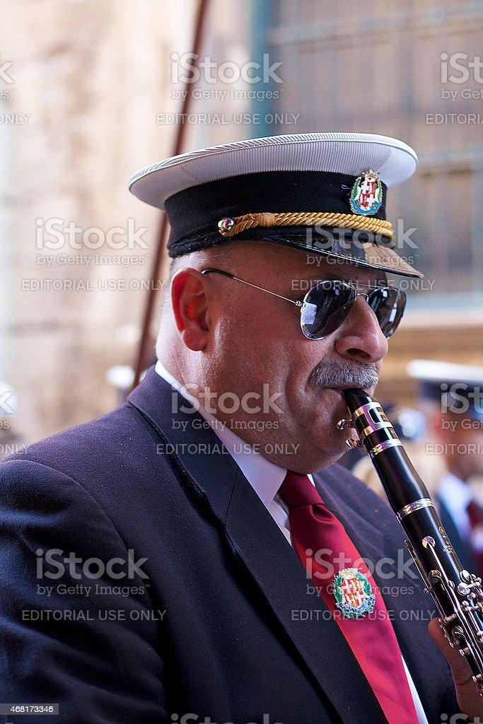 Uomo che suona il flauto, Valletta foto stock royalty-free