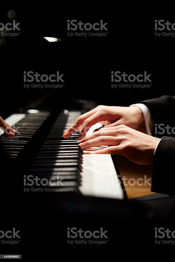 Man playing the grand piano stock photo