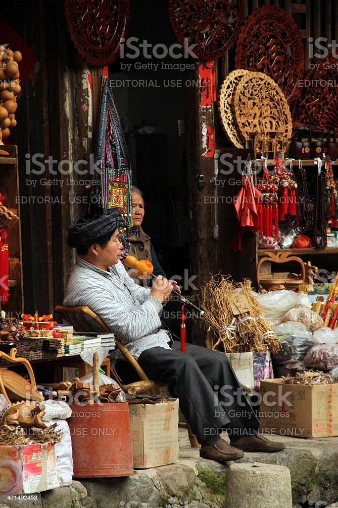 Man Playing the Hulusi, Fujian royalty-free stock photo