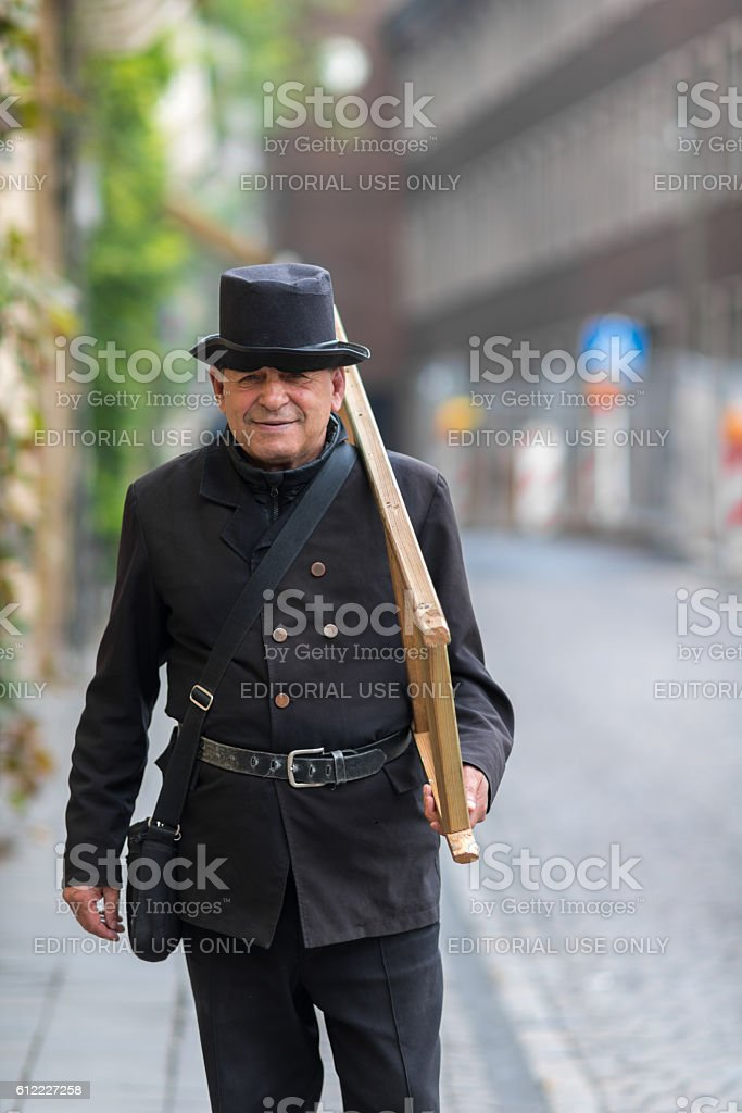man playing the role of a chimney sweeper stock photo