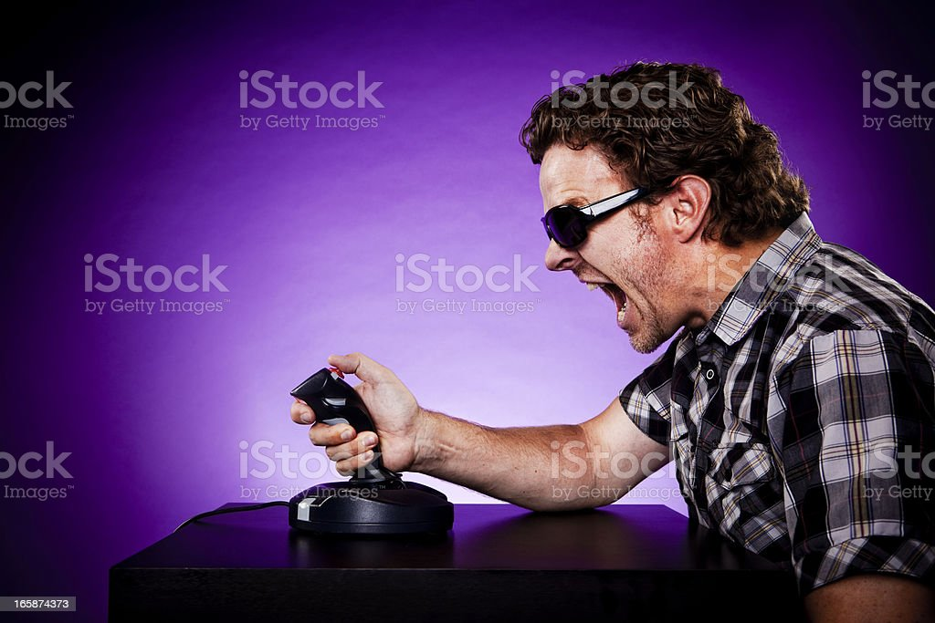Man Playing Video Games With A Joystick royalty-free stock photo