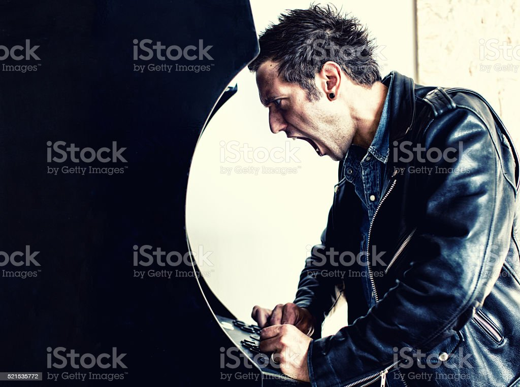 Man playing vintage videogame stock photo
