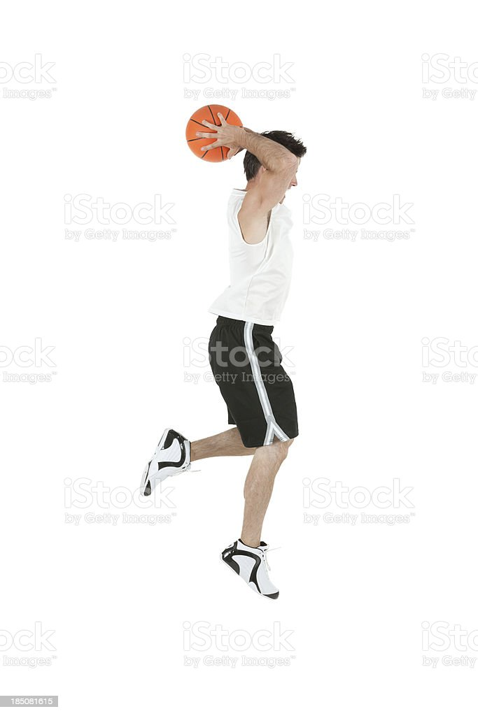 Man playing with a basketball stock photo
