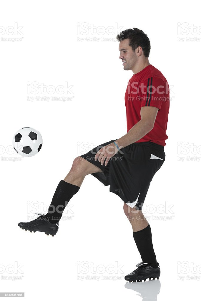 Man playing with a football royalty-free stock photo