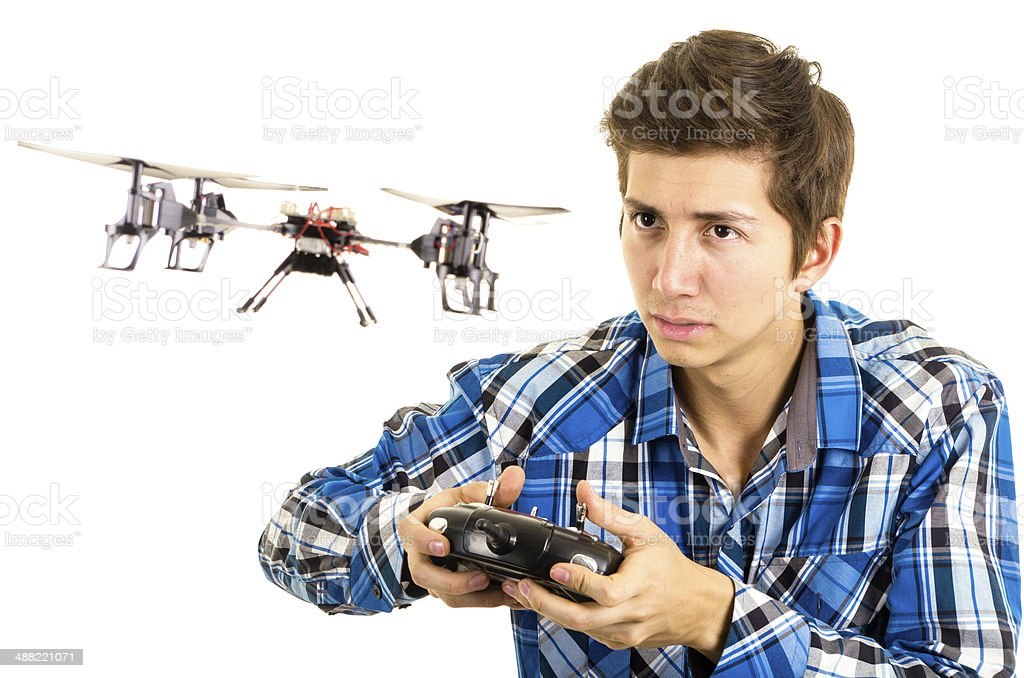 man playing with a quadcopter drone stock photo