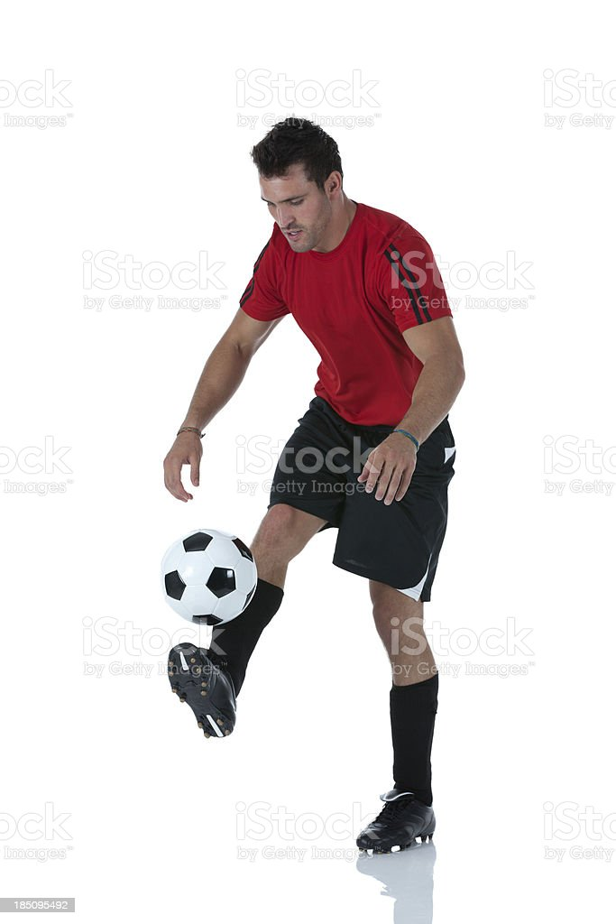 Man playing with a soccer ball royalty-free stock photo