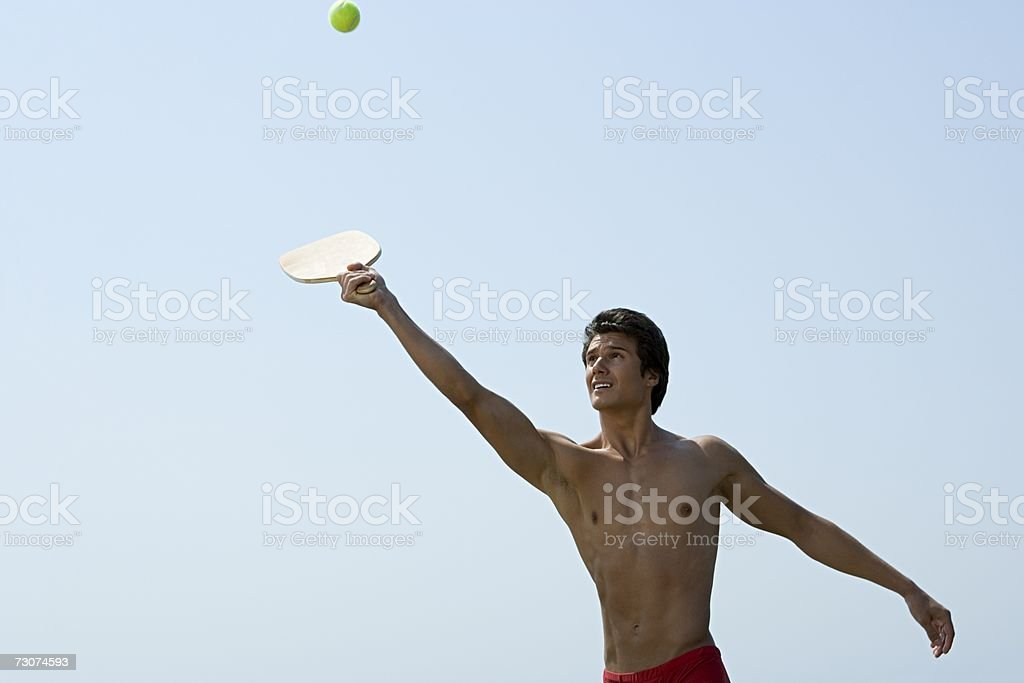Man playing with bat and ball stock photo