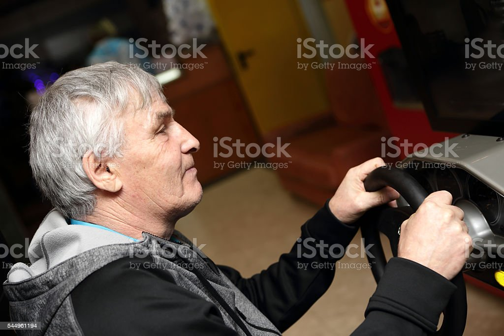 Man playing with car simulator stock photo