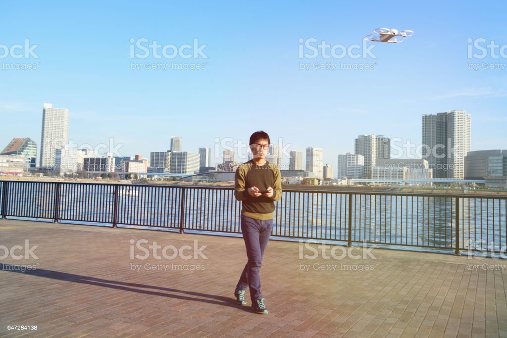 Man Playing with Drone stock photo