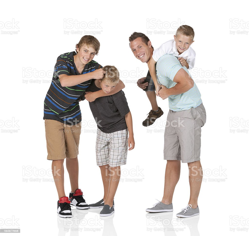 Man playing with his children stock photo