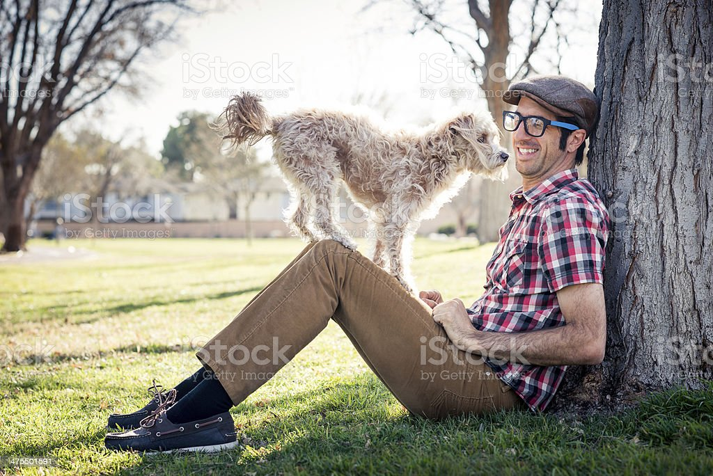 Man Playing With His Dog royalty-free stock photo