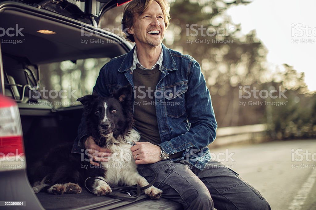 Man playing with his dog stock photo