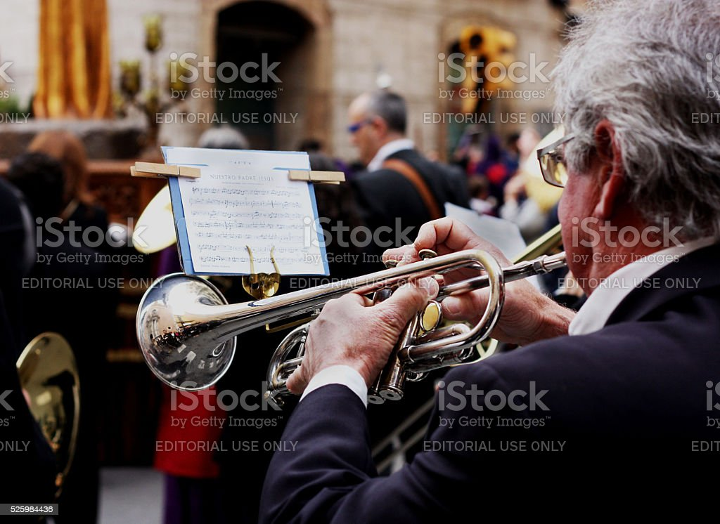 Man Playng Brass Lacquered Trumpet during Outdoor Concert stock photo