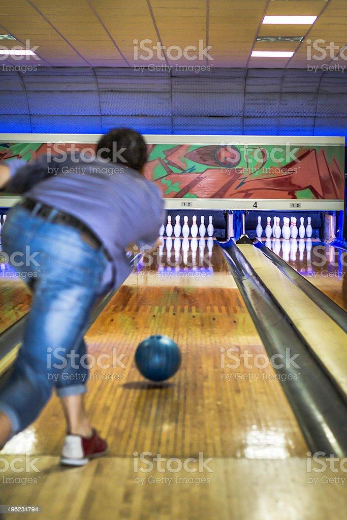 Man plays at bowling stock photo