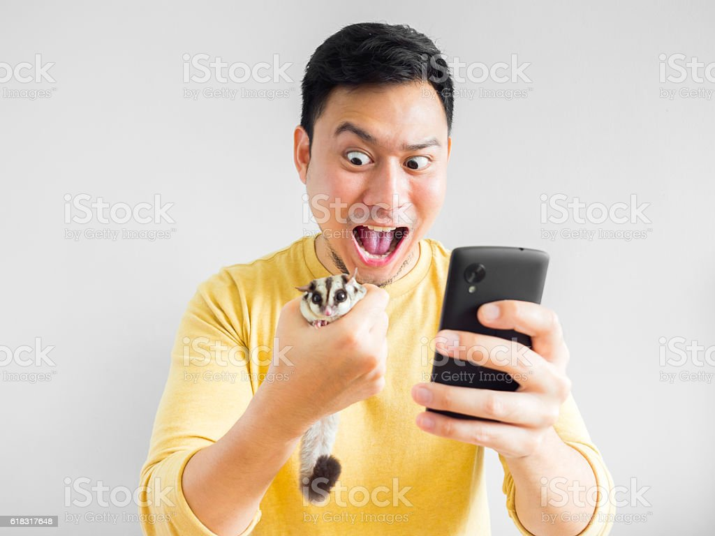 Man plays mobile game. stock photo