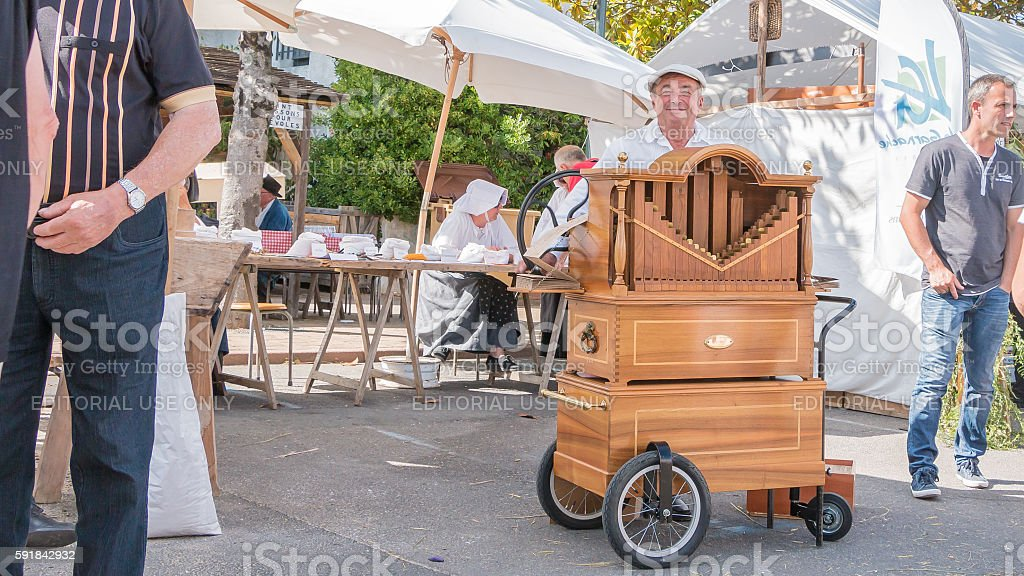 man plays the barrel organ in the street stock photo