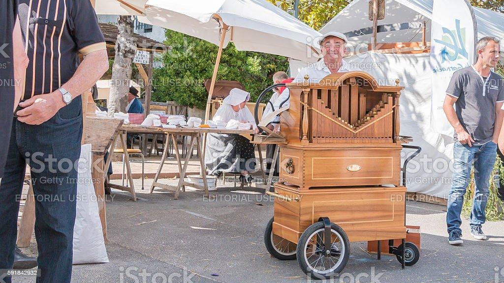 man plays the barrel organ in the street stock photo