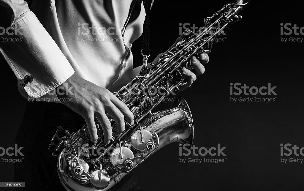 man plays the saxophone stock photo