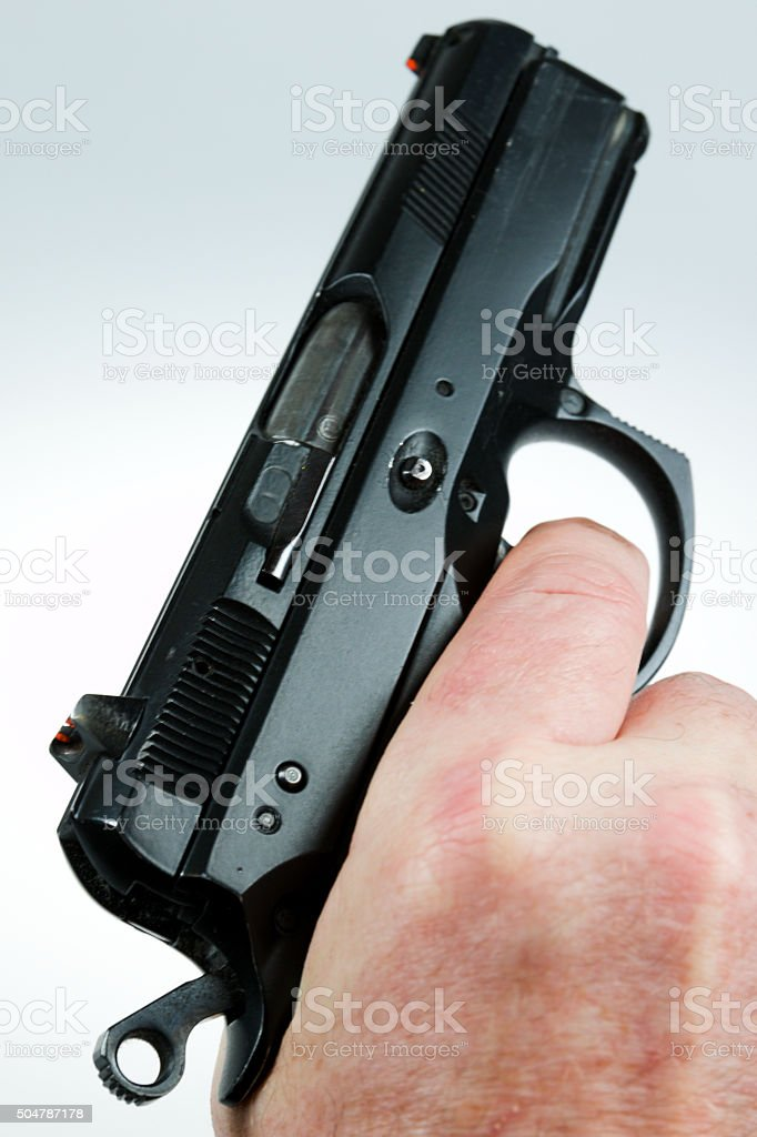 man pointing a weapon and weapon charges stock photo