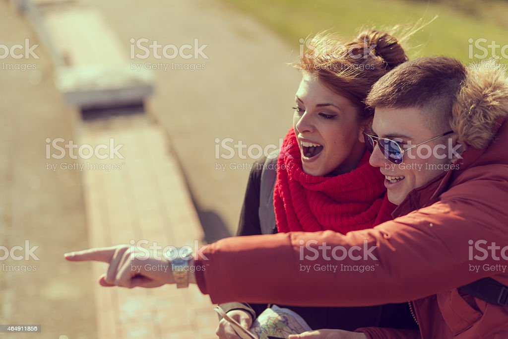 Man pointing and girl looking at it in awe stock photo