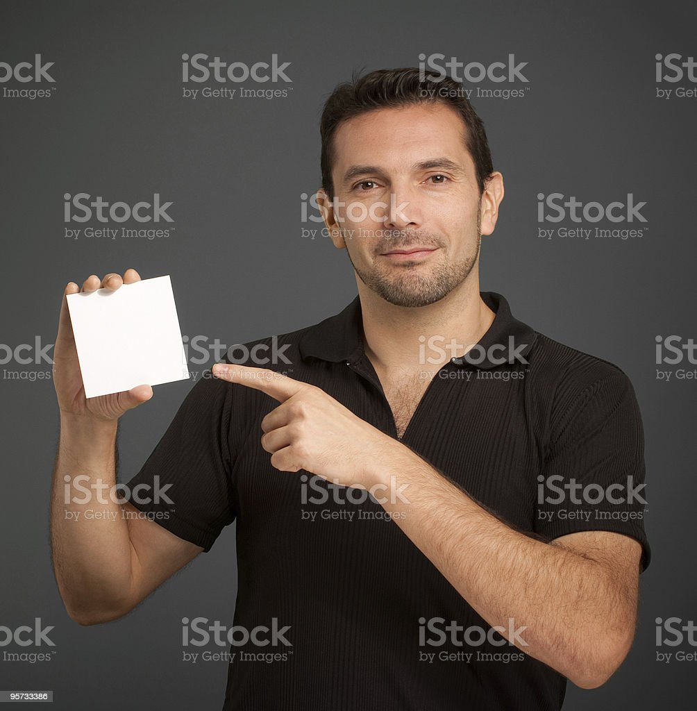 Man pointing at a blank card royalty-free stock photo