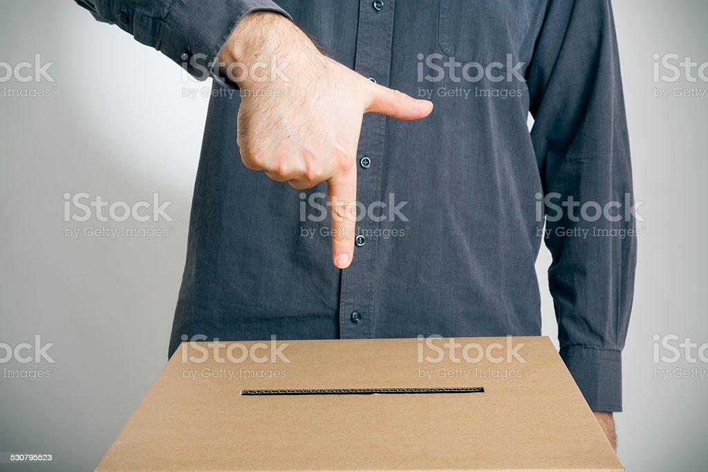 man pointing at ballot box stock photo