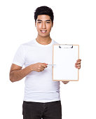 Man pointing at blank clipboard