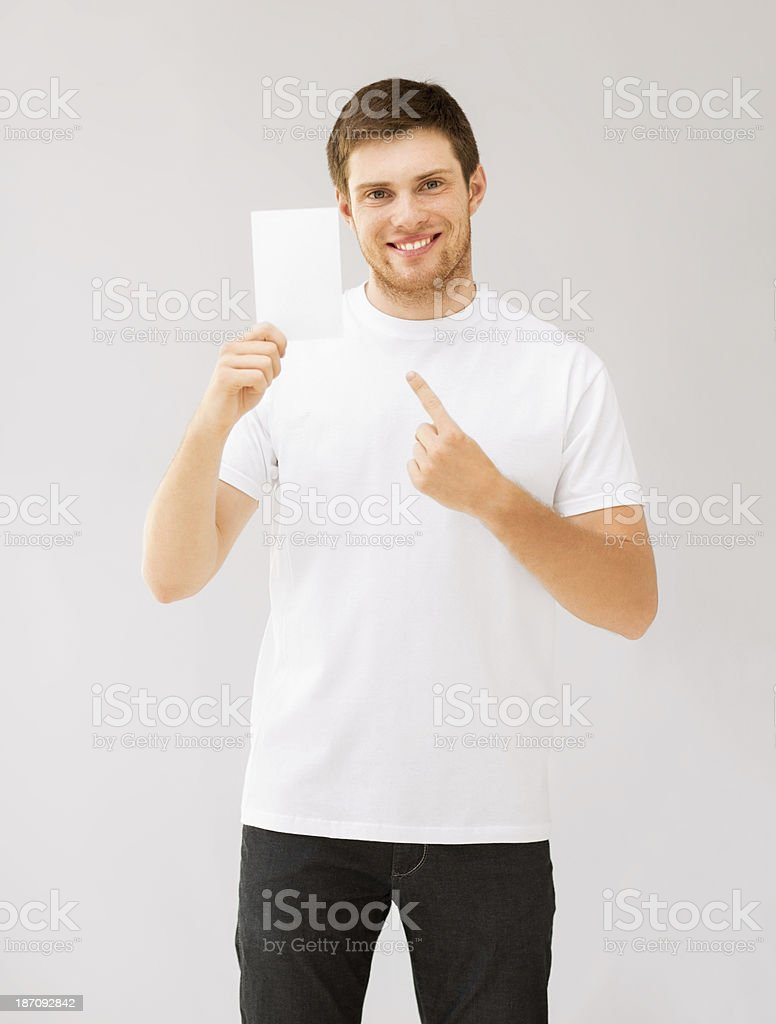 man pointing at blank white paper royalty-free stock photo