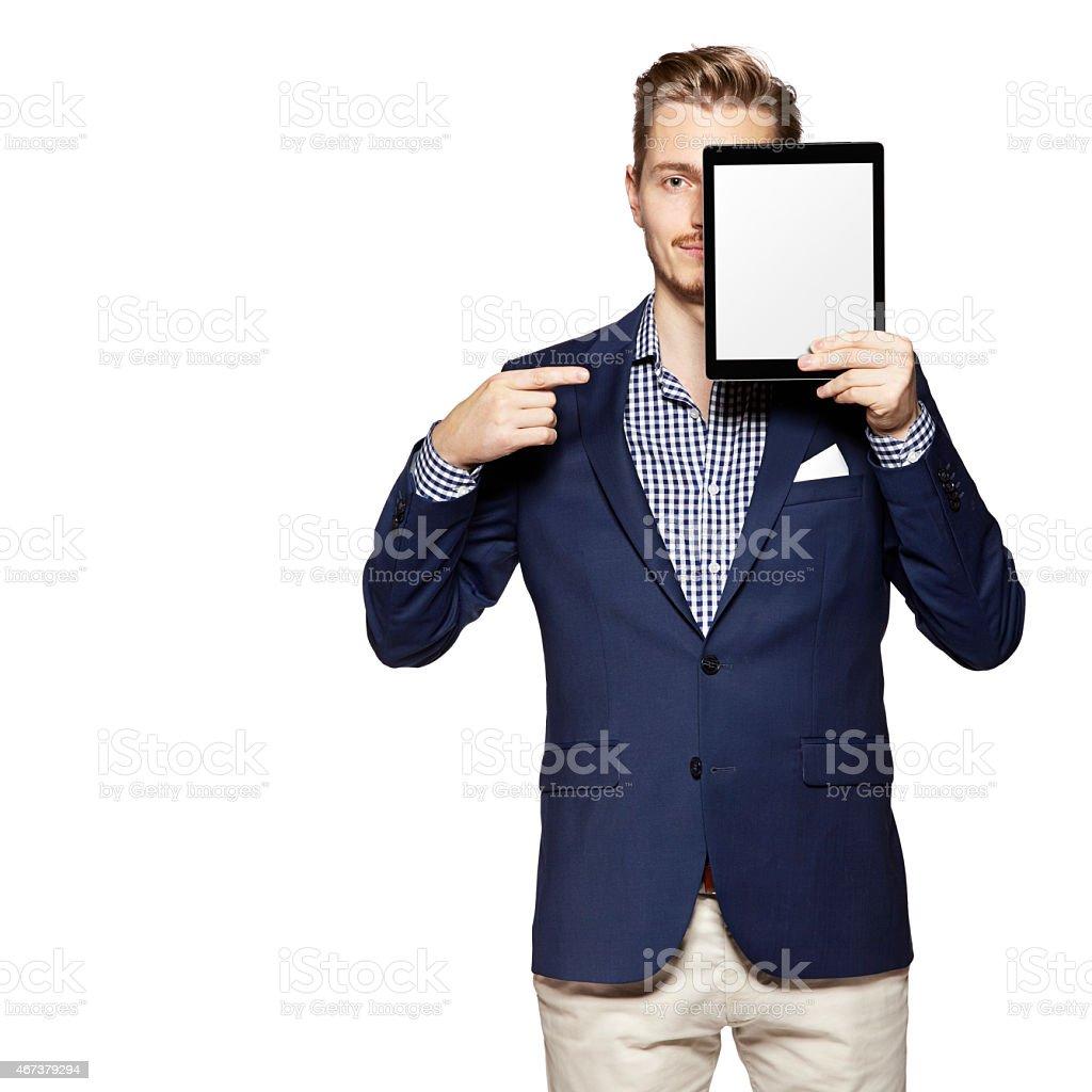 Man pointing at digital tablet stock photo