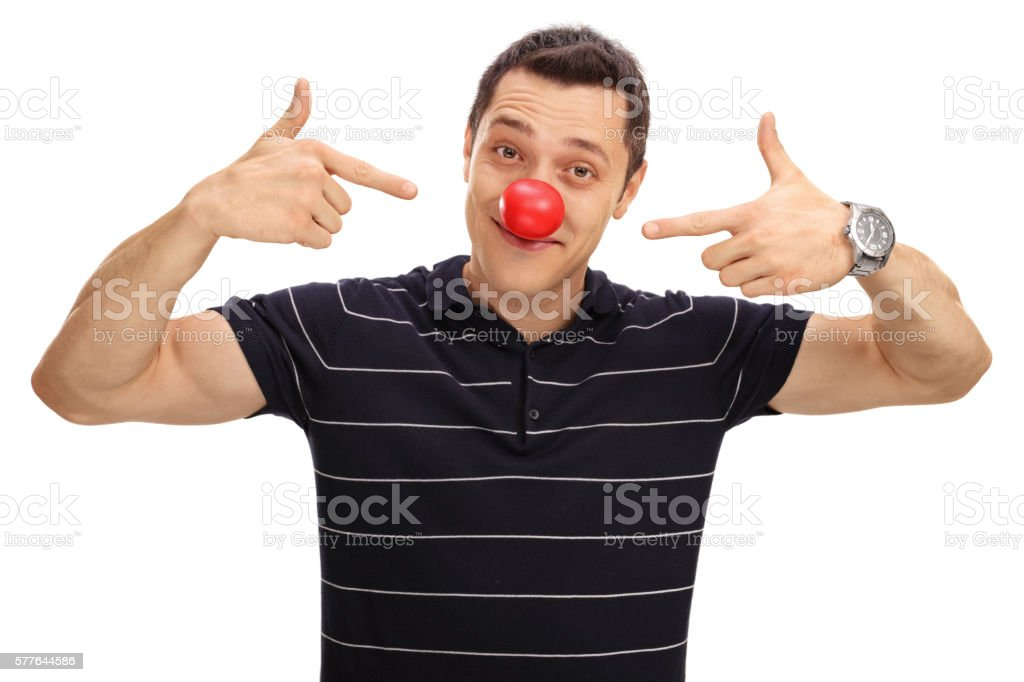 Man pointing at his red clown nose stock photo