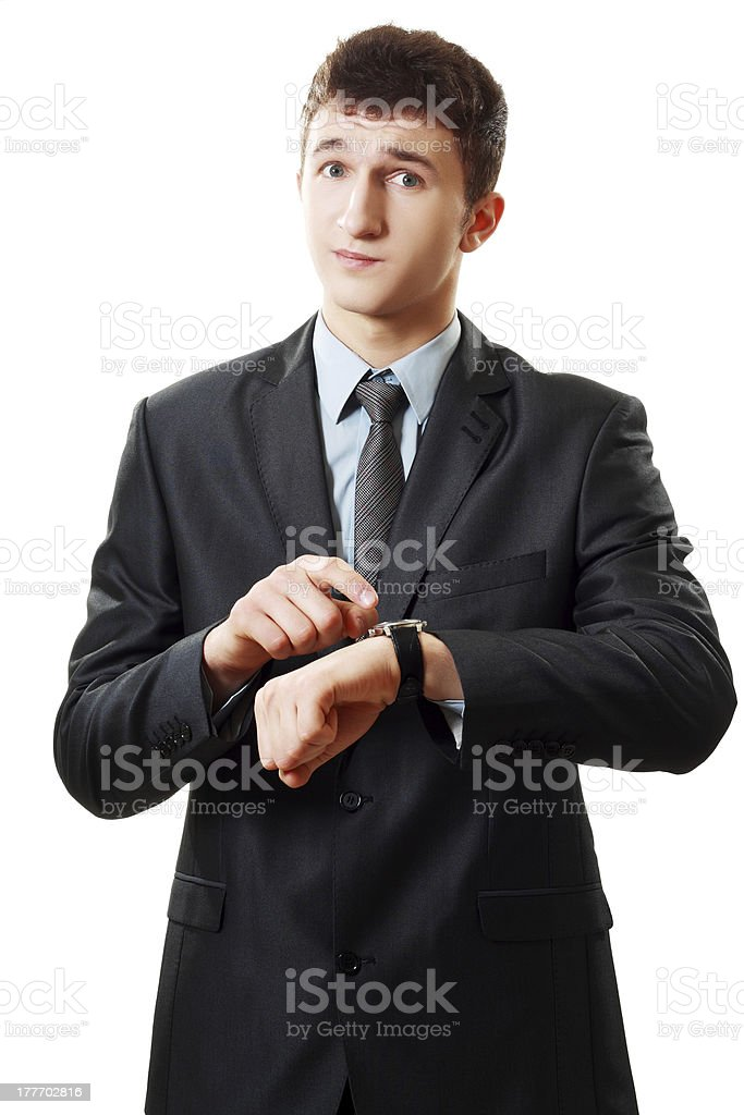 man pointing at his watch stock photo