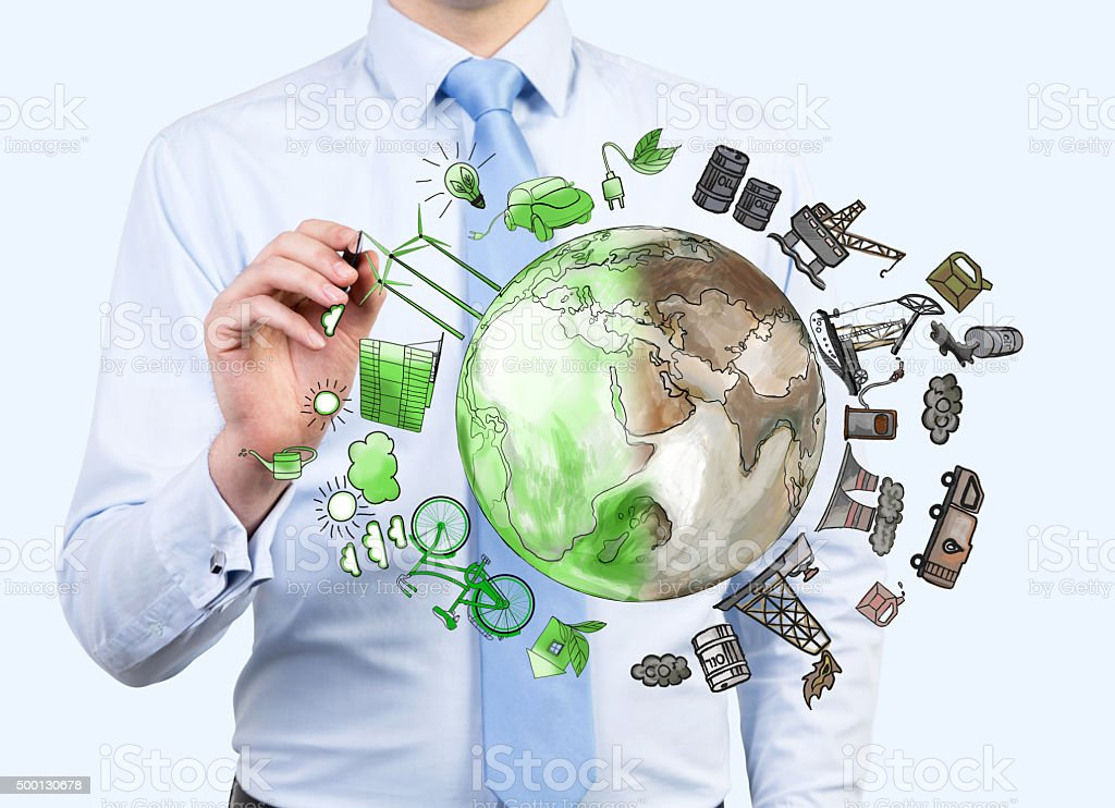man pointing at oil production and eco energy icons, environment stock photo